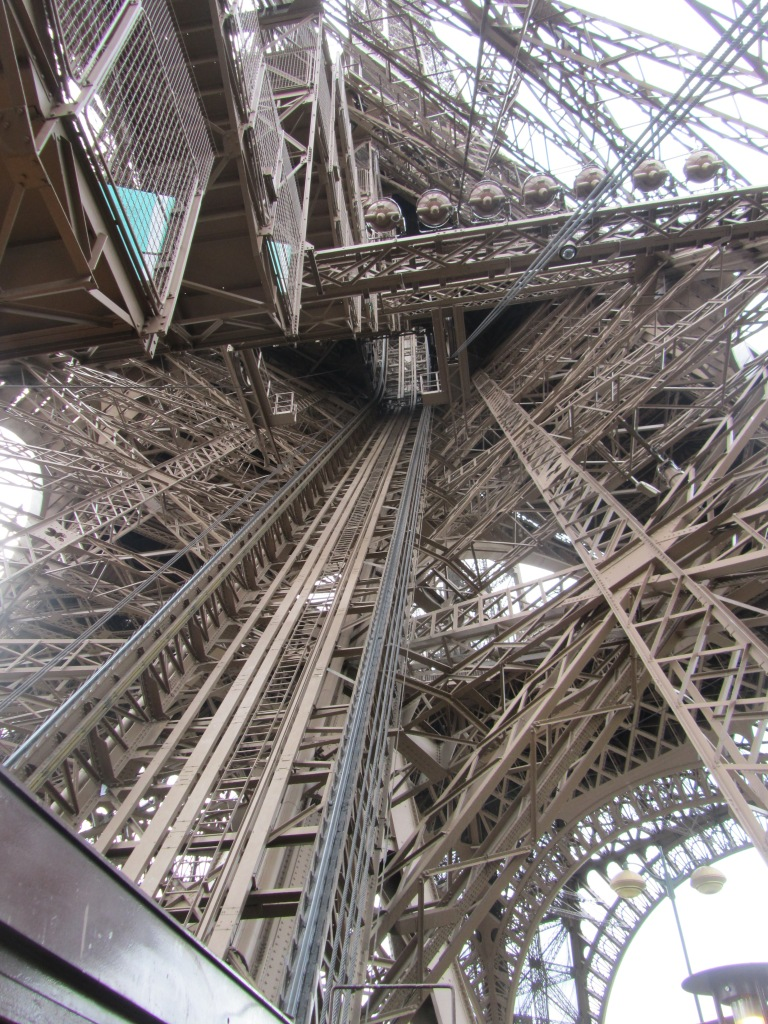 Look up from inside the Eiffel Tower